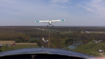A view from the cockpit of the sailplane as it is being towed into the sky by a powered aircraft